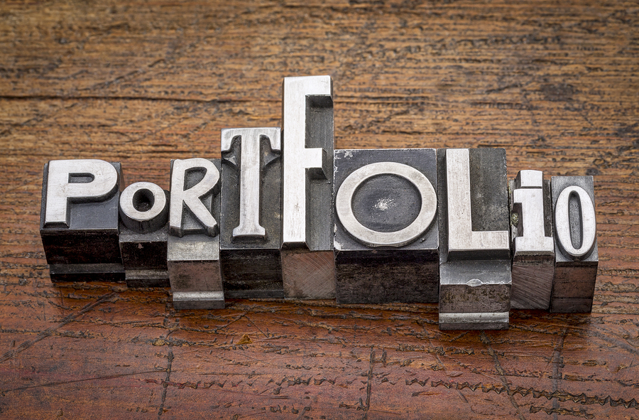 portfolio  word in mixed vintage metal type printing blocks over